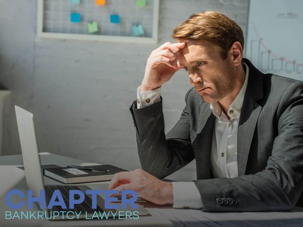 Worried man reading a deficiency memo in his laptop